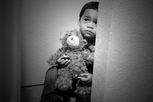 young boy with bear