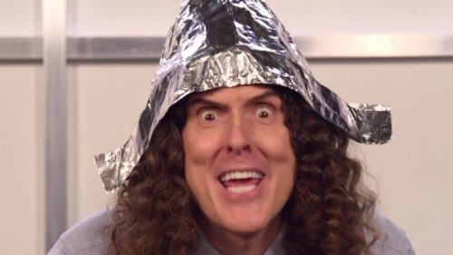 Weird Al wearing a tin foil hat