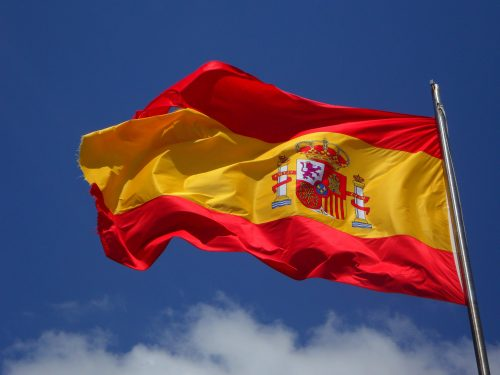 Spanish flag flying on a flagpole